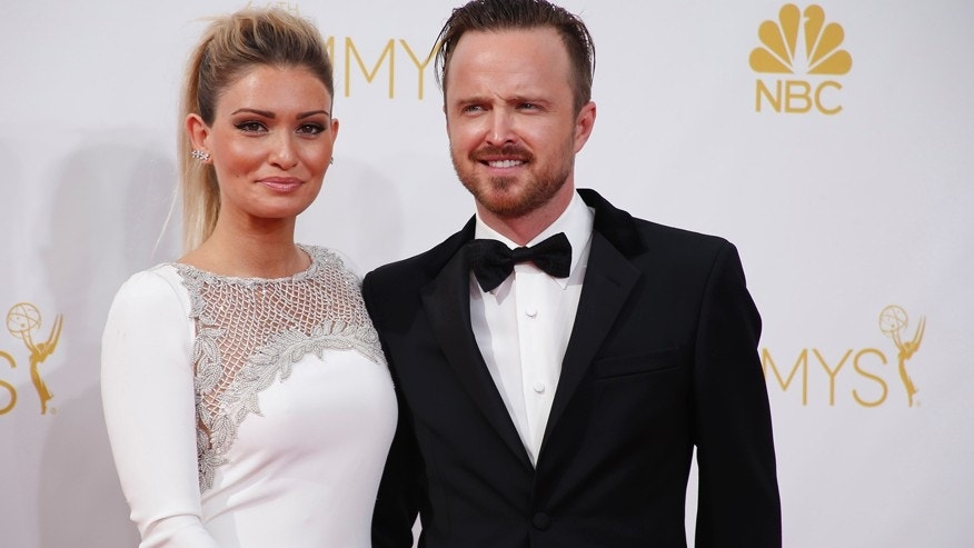 """Aaron Paul from the AMC series """"Breaking Bad"""" and his wife, Lauren Parsekian, arrive at the 66th Primetime Emmy Awards in Los Angeles, California August 25, 2014."""