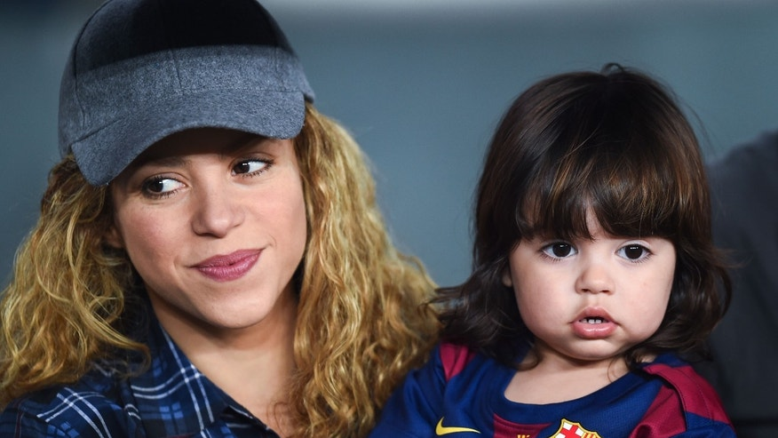 BARCELONA, SPAIN - OCTOBER 18:   Shakira and her son Milan look on during the La Liga match between FC Barcelona and SD Eibar at Camp Nou on October 18, 2014 in Barcelona, Spain.  (Photo by David Ramos/Getty Images)
