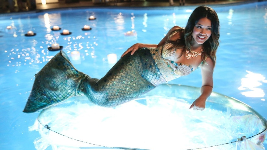 "In this image released by The CW, Gina Rodriguez portrays Jane in the new series, ""Jane The Virgin,"" premiering Monday, Oct. 13, 2014. (AP Photo/The CW, Tyler Golden)"
