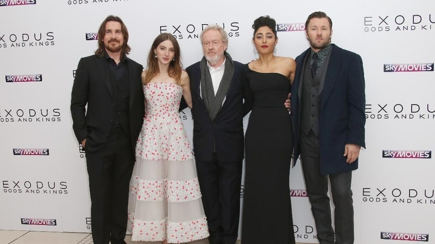 "FILE - In this Wednesday, Dec. 3, 2014 file photo, from left, actors Christian Bale, Maria Valverde, Director Ridley Scott, Golshifteh Farahani and Joel Edgerton pose for photographers upon arrival at the World premiere of the film, ""Exodus: Gods And Kings,"" in London. The movie opens Friday, Dec. 12, 2014. (Photo by Joel Ryan/Invision/AP, File)"