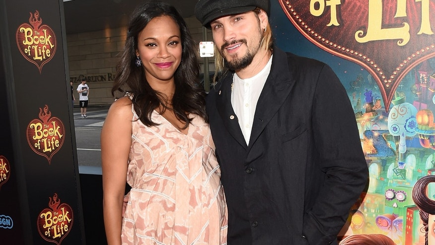 "LOS ANGELES, CA - OCTOBER 12:  Actors Zoe Saldana and Marco Perego attend the Twentieth Century Fox and Reel FX Animation Studios premiere of ""The Book of Life"" on Sun, Oct 12, 2014, in Los Angeles.  (Photo by Jason Merritt/Getty Images)"