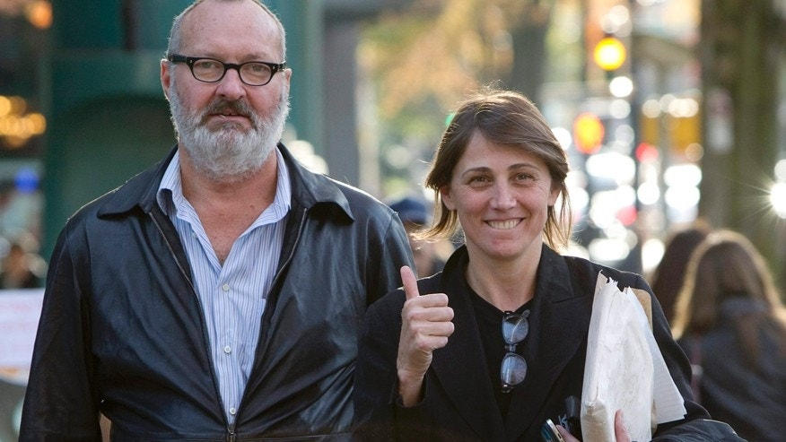 "FILE - This Oct. 27, 2010 file photo shows, actor Randy Quaid, left, and his wife Evgenia outside their lawyer's office in Vancouver. Quaid and his wife sued John Kerry and the State Department on Monday, Dec. 15, 2014, to recover passports that the government revoked three years ago. The actor said the revocation involved an issue over ""an insurance policy that we did not take out,"" but declined to discuss it further."
