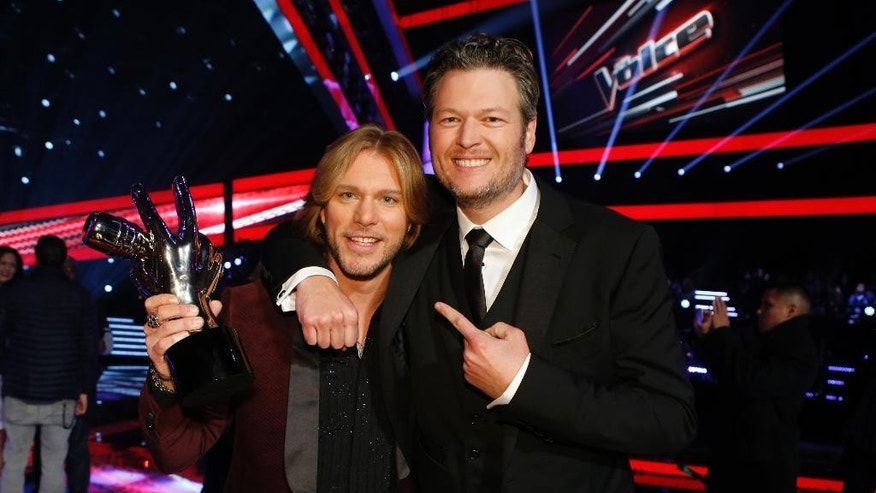 "In this image provided by NBC-TV Craig Wayne Boyd, left poses with Blake Shelton Tuesday Dec. 16, 2014. Craig Wayne Boyd, the country rocker from Blake Shelton's team, was named the winner of ""The Voice"" Tuesday. (AP Photo/NBC-TV, Trae Patton)"