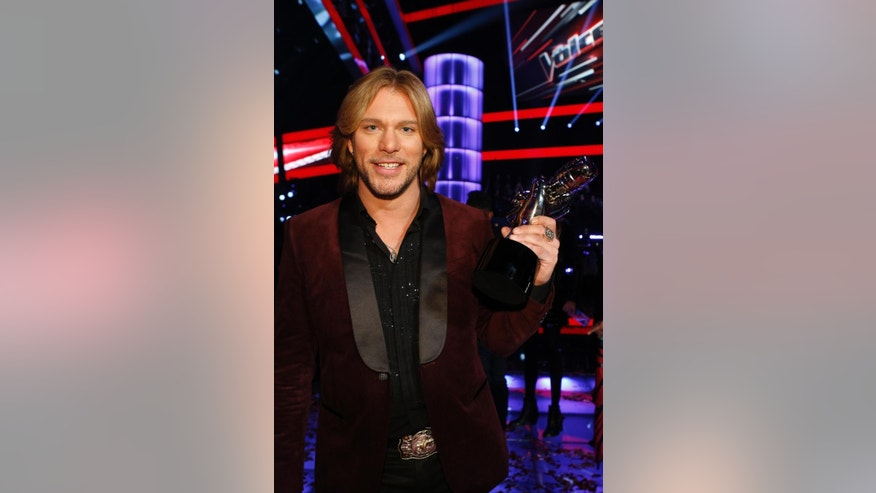 "In this image provided by NBC-TV Craig Wayne Boyd, poses his award Tuesday Dec. 16, 2014. Craig Wayne Boyd, the country rocker from Blake Shelton's team, was named the winner of ""The Voice"" Tuesday. (AP Photo/NBC-TV, Trae Patton)"