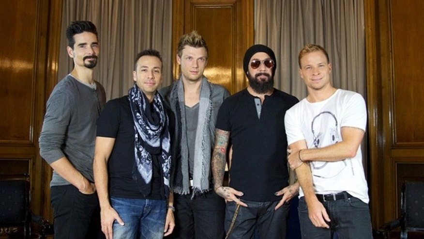 "MADRID, SPAIN - NOVEMBER 12:  (L-R) Kevin Richardson, Howie Dorough, Nick Carter, A.J. Maclean and Brien Littrell of Backstreet Boys present their new album ""In A World Like This"" at the Palace Hotel on November 12, 2013 in Madrid, Spain.  (Photo by Carlos Alvarez/Getty Images)"