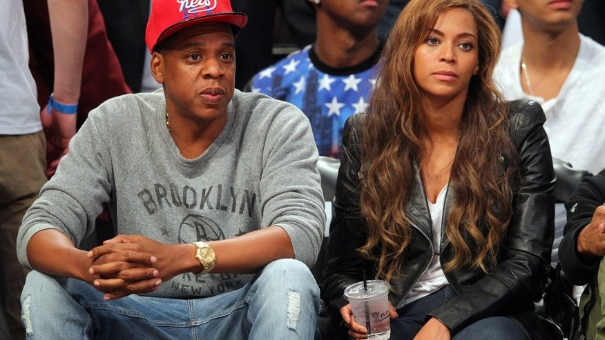 May 2, 2014; Brooklyn, NY, USA; Recording artists Jay-Z and Beyonce look on during the third quarter of game six of the first round of the 2014 NBA Playoffs between the Brooklyn Nets and the Toronto Raptors at Barclays Center.
