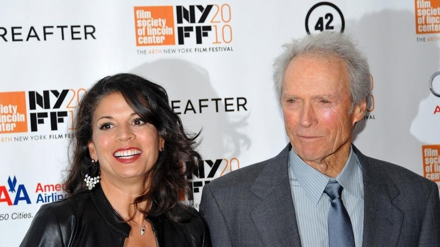 "FILE - In this Oct. 10, 2010 file photo, director and producer Clint Eastwood, right, and wife Dina Marie Eastwood attend the premiere of ""Hereafter"" at Alice Tully Hall during the 48th New York Film Festival, in New York. A Monterey County Superior Court judge finalized the couple's divorce after 18 years of marriage on Tuesday, Dec. 23, 2014.  (AP Photo/Evan Agostini, File)"