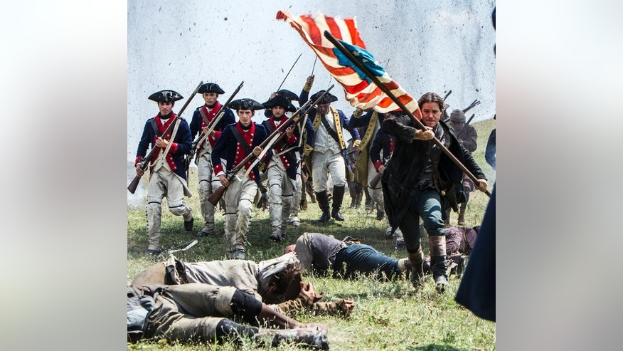 "In this 2014 photo released by the History Channel, actors portray Revolutionary War soldiers in a scene from ""Sons of Liberty,"" a new miniseries premiering in January 2015 on the History Channel. (AP Photo/History Channel, Ollie Upton)"