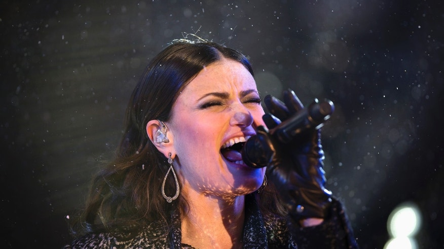 December 31, 2014. Singer Idina Menzel performs in Times Square on New Year's Eve in New York.