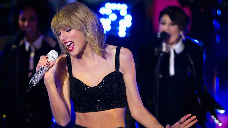 December 31, 2014. Taylor Swift performs in Times Square on New Year's Eve in New York.