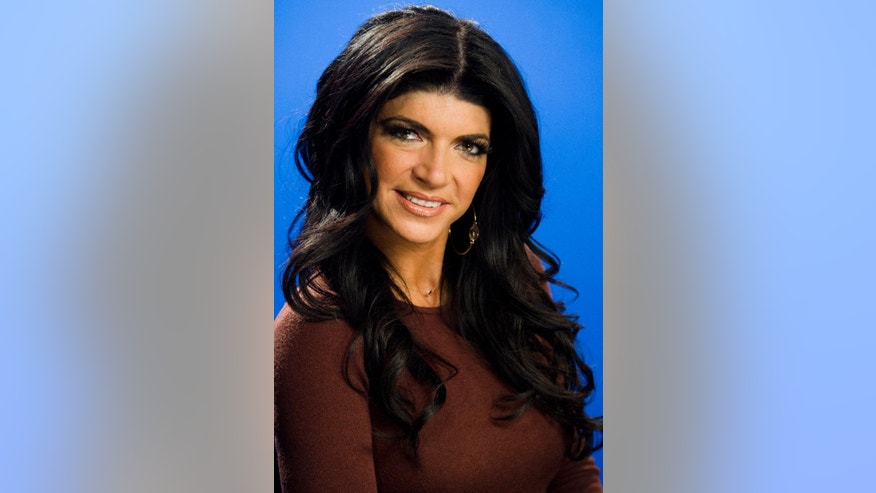 File- This Jan. 4, 2012, photo shows Teresa Giudice posing for a portrait in New York. Giudice is scheduled to report to a federal prison in Danbury, Connecticut on Monday, Jan. 5, 2015, to begin serving a 15-month sentence for bankruptcy fraud. She and husband Joe Giudice pleaded guilty last year. The couple admitted hiding assets from bankruptcy creditors and submitting phony loan applications to get some $5 million in mortgages and construction loans. (AP Photo/Charles Sykes, File)