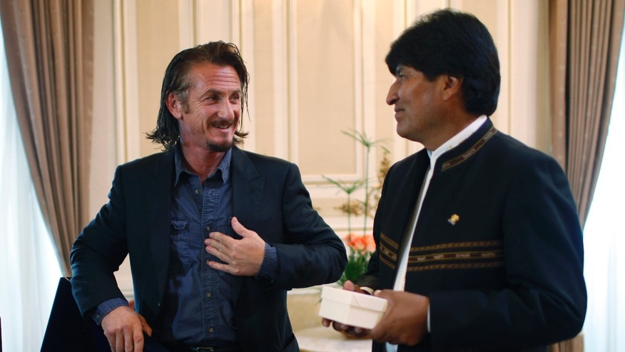 FILE - In this Oct. 30, 2012 file photo, actor Sean Penn talks to Bolivia's President Evo Morales during a photo call at the government palace in La Paz, Bolivia. Penn became convinced that U.S. businessman Jacob Ostreicher had been unjustly imprisoned in Bolivia since mid-2011 so corrupt authorities could drain the assets of the $25 million rice-farming operation in which he was a minor investor. When Penn asked Morales to intercede, Penn got a tepid response. So he exposed the extortion ring, sparking a major scandal that eventually would see 14 Bolivian officials jailed. (AP Photo/Juan Karita, File)