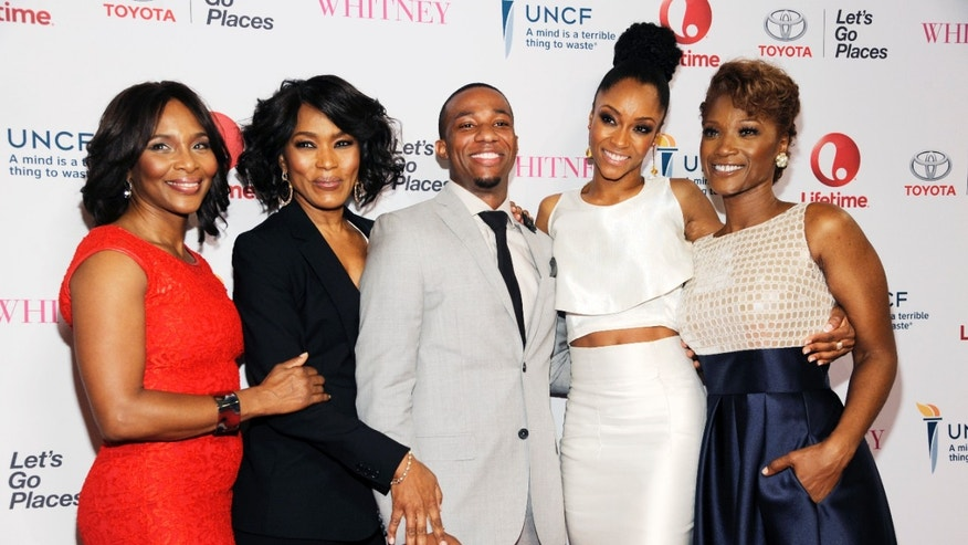 "Jan 6, 2015. Actress Angela Bassett, second from left, making her directorial debut with the Lifetime film ""Whitney,"" poses with cast members, left to right, Suzzanne Douglas, Arlen Escarpeta, Yaya DaCosta and Yolonda Ross at the premiere of the film at the Paley Center for Media in Beverly Hills."