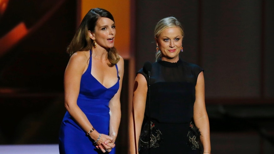 September 22, 2103. Tina Fey (L) and Amy Poehler present the award for Outstanding Supporting Actress In A Comedy Series at the 65th Primetime Emmy Awards in Los Angeles.
