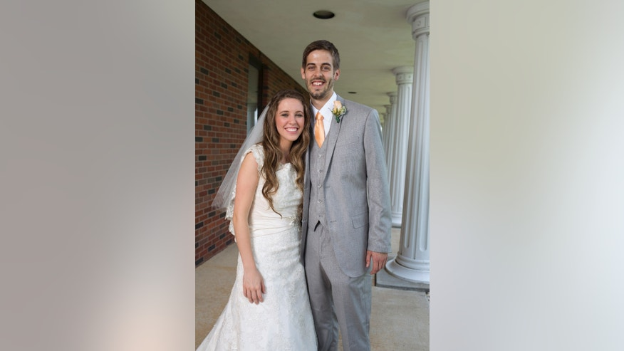 June 21, 2014. Jill Duggar and Derick Dillard on their wedding date in Springdale, Arkansas.