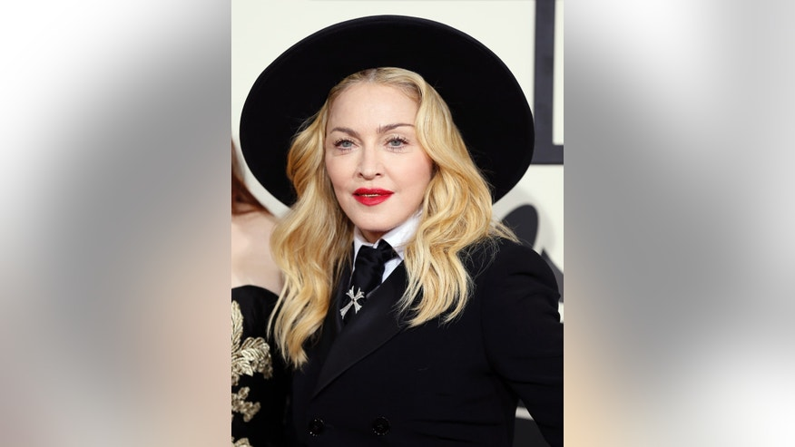 January 26, 2014. Madonna arrives at the 56th annual Grammy Awards in Los Angeles, California.