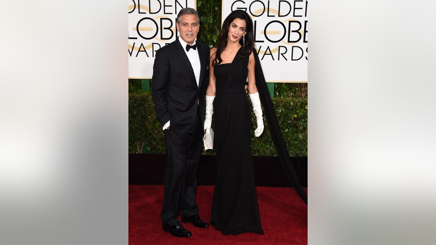 George Clooney, left, and Amal Clooney arrive at the 72nd annual Golden Globe Awards at the Beverly Hilton Hotel on Sunday, Jan. 11, 2015, in Beverly Hills, Calif. (Photo by Jordan Strauss/Invision/AP)