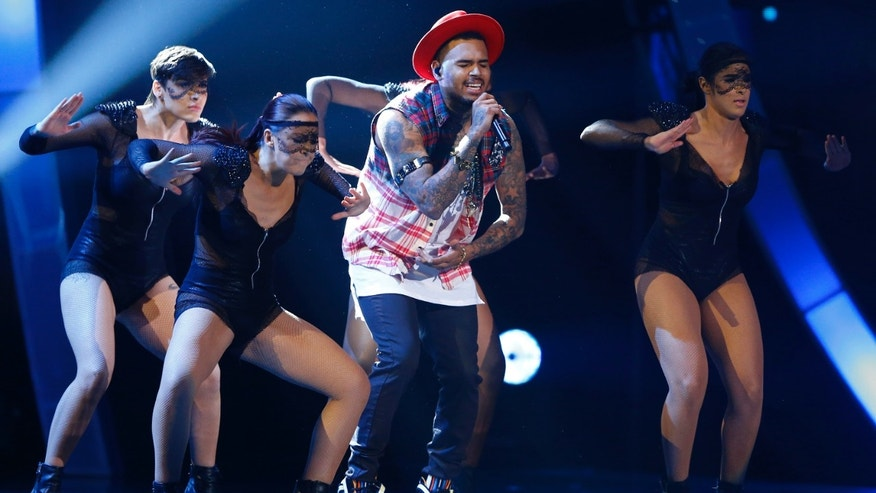 Chris Brown performs at the15th Annual Latin Grammy Awards in Las Vegas, Nevada.