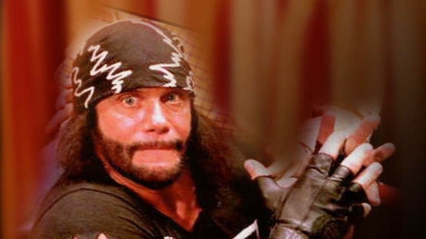 "In this undated publicity image released by WWE, professional wrestler Randy ""Macho Man"" Savage is shown. Savage, whose legal name is Randy Mario Poffo, died in a car crash in Florida on Friday, May 20, 2011, according to a Florida Highway Patrol crash report. (AP Photo/WWE) ** NO SALES **"