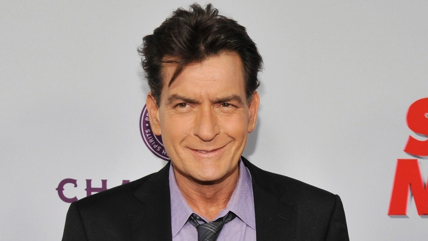 "FILE - In this April 11, 2013 file photo, Charlie Sheen, a cast member in ""Scary Movie V,"" poses at the Los Angeles premiere of the film at the Cinerama Dome in Los Angeles. Sheen was sued in Los Angeles Friday, Oct. 3, 2014, by a dental technician who claims the actor punched her in the chest and was abusive during an office visit in late September. (Photo by Chris Pizzello/Invision/AP, file)"
