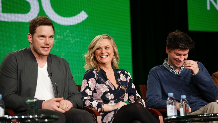 "January 16, 2015. Chris Pratt and Amy Poehler, and producer Mike Schur (L-R) speak about the NBC television show ""Parks and Recreation"" during the TCA presentations in Pasadena, California."