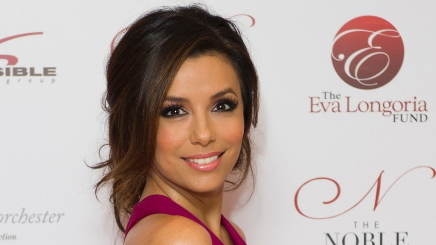 U.S actress Eva Longoria arrives for the Noble Gift Gala, at a central London venue, Saturday, Dec. 10, 2011. (AP Photo/Jonathan Short)