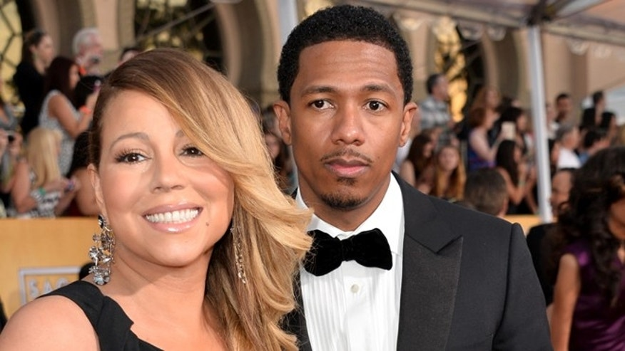 Singer Mariah Carey (L) and TV personality Nick Cannon attend the 20th Annual Screen Actors Guild Awards at The Shrine Auditorium on January 18, 2014 in Los Angeles, California.  (Photo by Alberto E. Rodriguez/Getty Images)