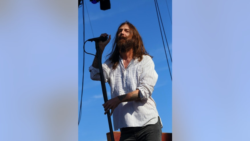 FILE - In this Sept. 7, 2013 file photo, Chris Robinson of The Black Crowes performs on day 3 of the Lockn' Festival at Oak Ridge Farm, in Arrington Va. Founding member Rich Robinson announced Thursday, Jan. 15, 2015, the group is disbanding after 24 years. Robinson, the band's guitarist and songwriter, founded the group with his brother and lead singer, Chris Robinson. (Photo by John Davisson/Invision/AP, File)