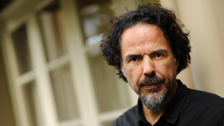 "In this Wed., Dec. 17, 2014 photo, Alejandro Gonzalez Inarritu, director of the film ""Birdman,"" poses for a portrait at the Four Seasons Hotel in Los Angeles. Inarritu says there was only one way to tell the story of a celebrity's struggle with ego in ""Birdman,"" and that was with long, uninterrupted takes that move at the speed of life. (Photo by Chris Pizzello/Invision/AP)"
