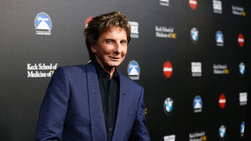 "March 20, 2014. Musician Barry Manilow poses at the second annual ""Rebels With a Cause"" gala at Paramount Pictures Studios in Los Angeles, California."
