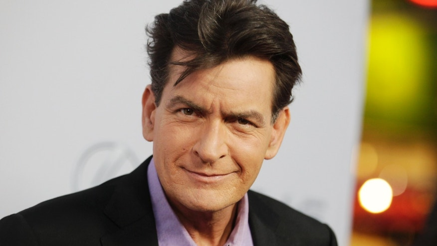 "April 11. 2013. Charlie Sheen poses at the premiere of his new film ""Scary Movie 5"" in Hollywood."