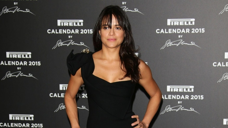 Michelle Rodriguez attends the 2015 Pirelli Calendar Red Carpet on November 18, 2014 in Milan, Italy.