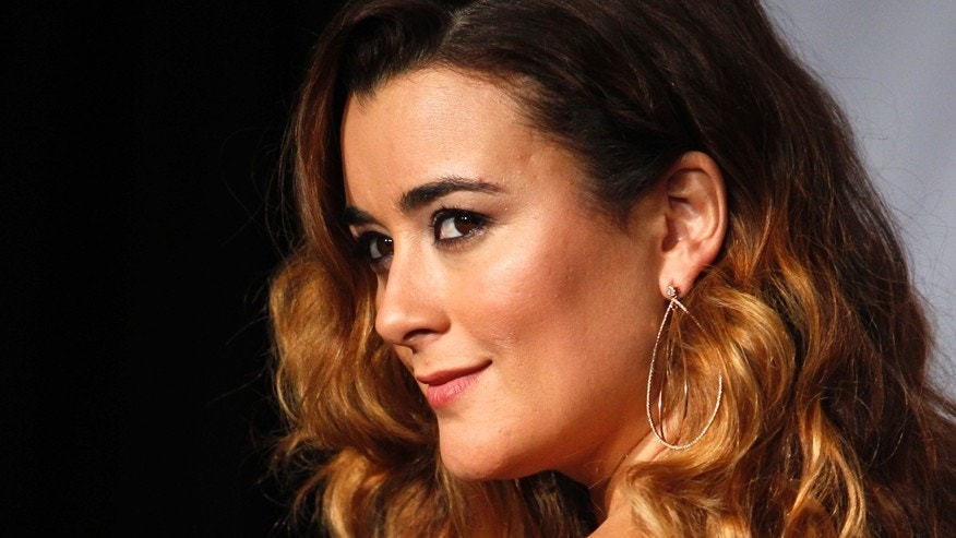 Cote de Pablo poses backstage during the 14th Latin Grammy Awards in Las Vegas, Nevada November 21, 2013.