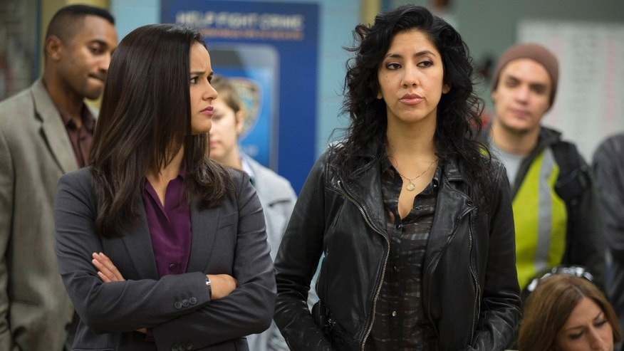"In this image released by Fox, Melissa Fumero, left, and Stephanie Beatriz appear in a scene from the comedy series, ""Brooklyn Nine-Nine."" Beatriz worked extensively in theater and enjoyed the freedom of appearing in a range of âcolorblindâ stage roles as well as playing specifically Latina characters. (AP Photo/Fox, John Fleenor)"