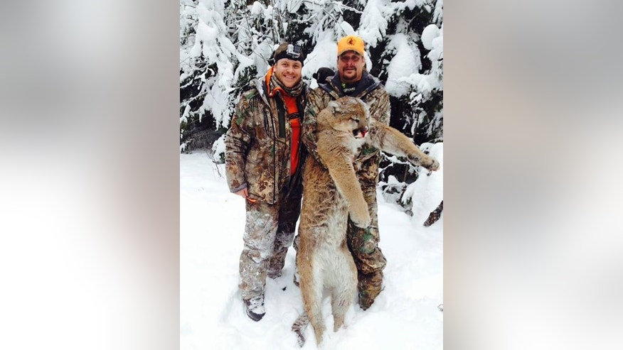 Kid Rock (right) and an identified friend on a hunting trip.