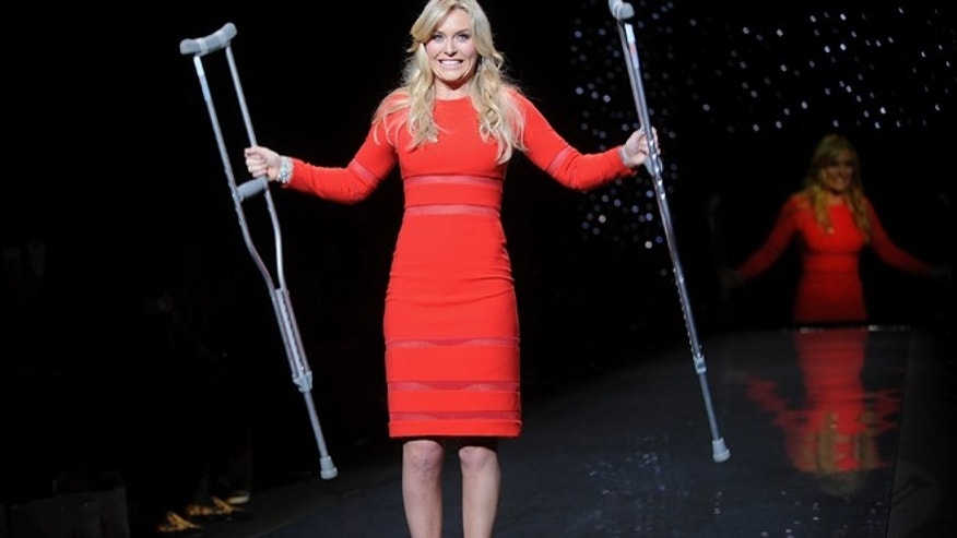 American World Cup alpine ski racer Lindsey Vonn walks the runway with crutches at the 2014 Red Dress Collection on Thursday, Feb 6, 2014 in New York.
