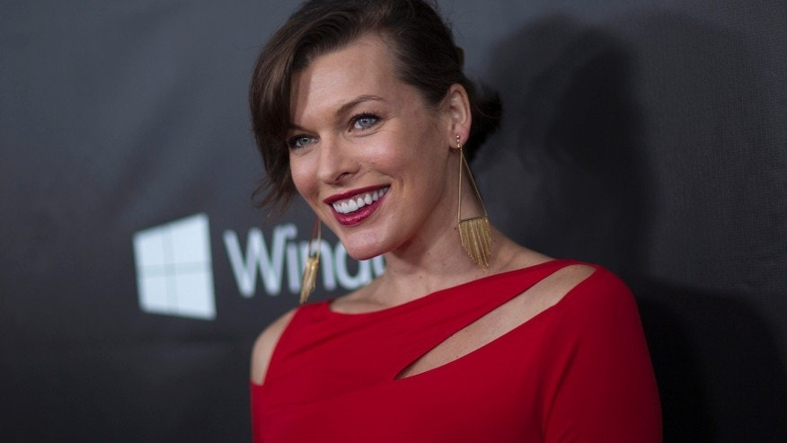Actress Milla Jovovich poses at amfAR's Fifth Annual Inspiration Gala in Los Angeles, California October 29, 2014.