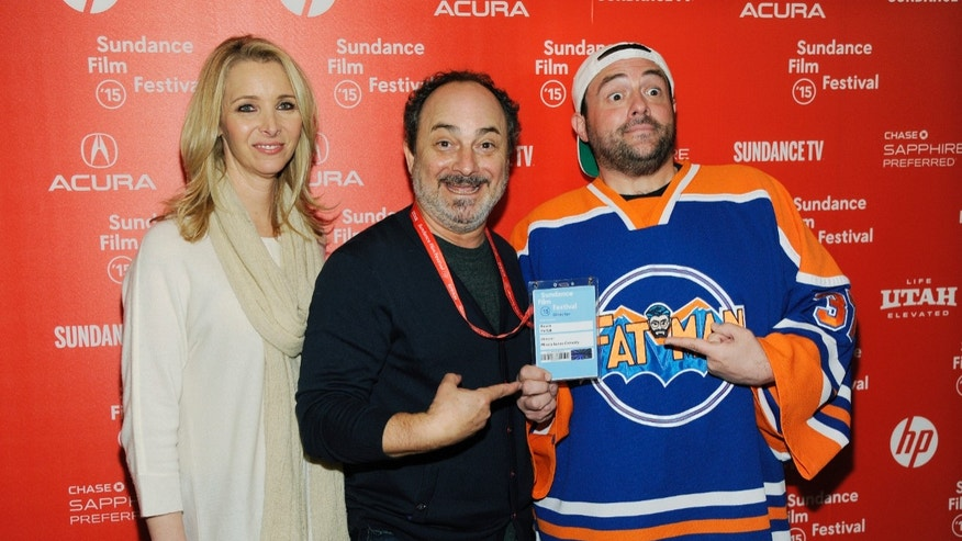 "Jan 22, 2015. Kevin Pollak, director and co-writer of the documentary film ""Misery Loves Comedy,"" center, poses with cast members Lisa Kudrow, left, and Kevin Smith at the premiere of the film at the Egyptian Theatre at the 2015 Sundance Film Festival in Utah."