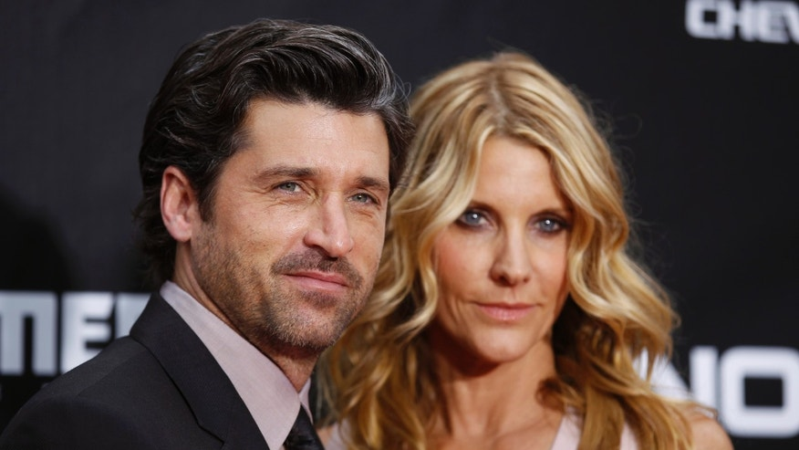 "June 28, 2011.  Patrick Dempsey arrives with his wife Jill Fink for the premiere of ""Transformers: Dark of The Moon"" in Times Square in New York."