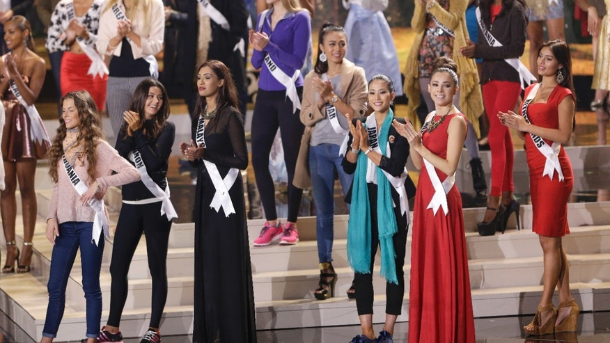 Jan 24, 2015. Miss Universe contestants clap as they rehearse at Florida International University in Miami. The Miss Universe pageant will be held Jan. 25, in Miami.
