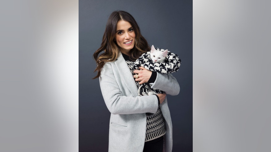 "Jan 24, 2015. Nikki Reed poses for a portrait to promote the ""Catdance Film Festival"" at the Eddie Bauer Adventure House during the Sundance Film Festival in Utah."
