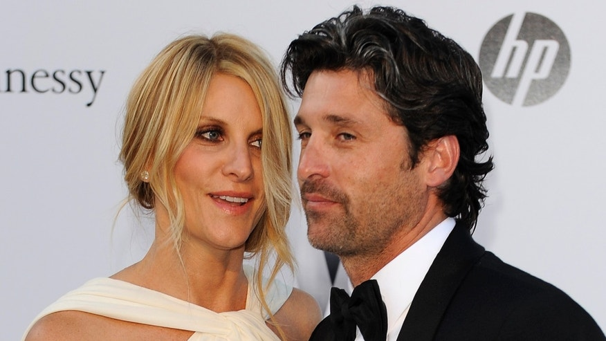 May 19, 2011. Patrick Dempsey, right, and his wife Jillian Fink arrive for the amfAR Cinema Against AIDS benefit at the Hotel du Cap-Eden-Roc, during the 64th Cannes international film festival.