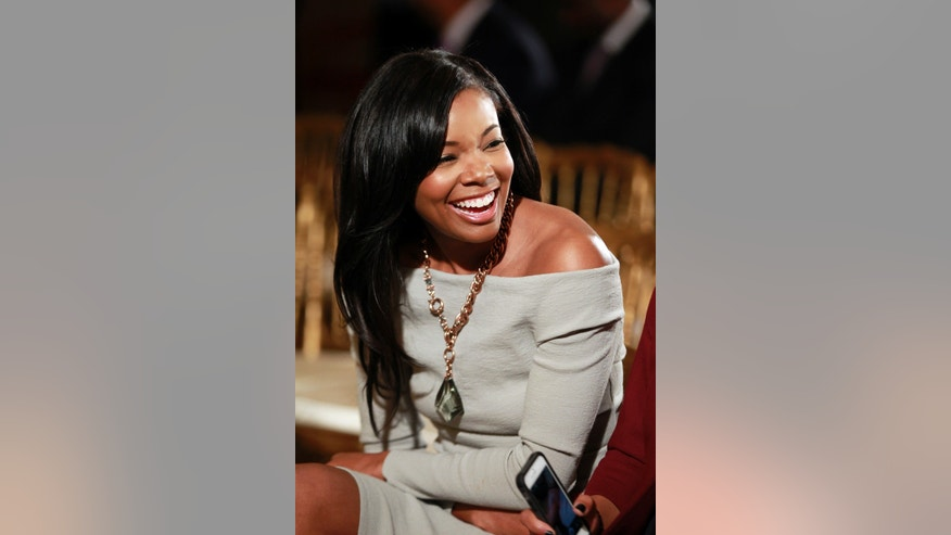 January 28, 2013. Gabrielle Union is pictured in the audience before U.S. President Barack Obama honors the 2012 NBA champions, the Miami Heat basketball team during a ceremony in the East Room of the White House in Washington.