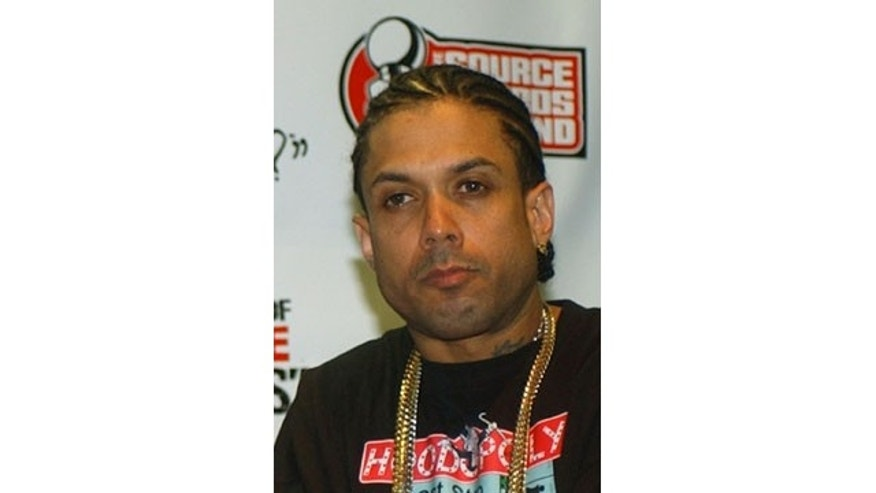 Occtober 10, 2004: This file photo shows Ray Benzino at the Source Hip-Hop Music Awards in Miami. Authorities say the reality TV star and rapper was shot and injured by his nephew while in a funeral procession for a family member in Massachusetts. Benzino, whose real name is Raymond Scott, is a cast member of the VH1 reality show Love & Hip Hop: Atlanta and former co-owner of The Source magazine. (AP Photo/Alan Diaz, File)