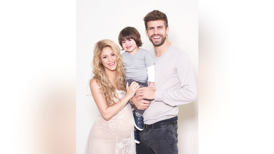 Shakira, Gerard Pique and son Milan pose for UNICEF World Baby Shower. (http://www.worldbabyshower.org/)