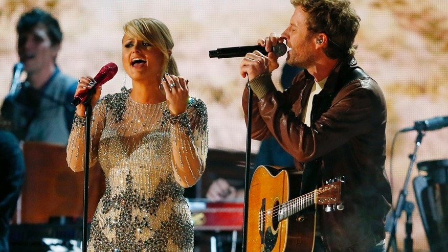 Miranda Lambert and Dierks Bentley perform at the 55th annual Grammy Awards in Los Angeles, California, February 10, 2013.