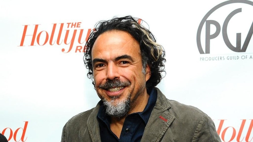 "FILE - In this Jan. 24, 2015 file photo released by Hollywood Reporter,  Alejandro Gonzalez Inarritu, director of ""Birdman,"" attends the Producers Guild Awards Nominees Breakfast hosted by The Hollywood Reporter at the Saban Theatre in Los Angeles. The film is also nominated for an Oscar. (AP Photo/The Hollywood Reporter, Vince Bucci, File)"