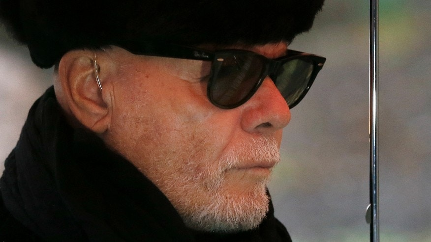 British pop star Gary Glitter, real name Paul Gadd, arrives at Southwark Crown Court in London, Thursday, Feb. 5, 2015.