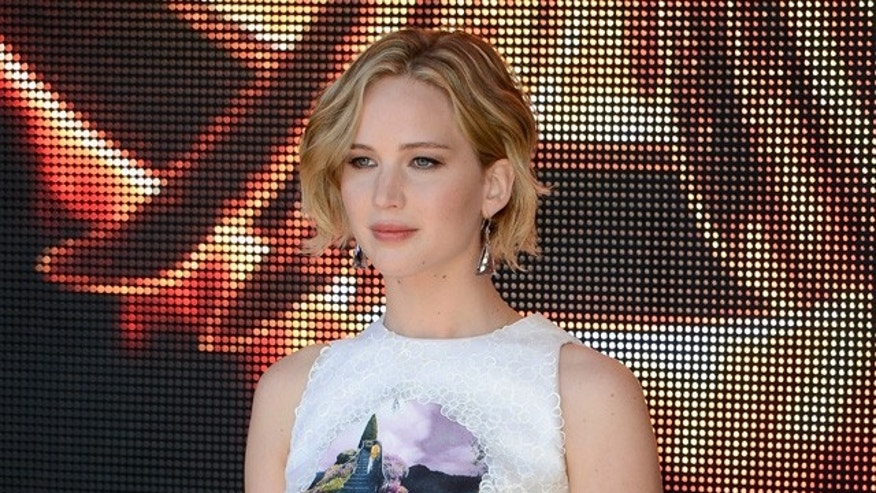 "CANNES, FRANCE - MAY 17:  Actress Jennifer Lawrence attends ""The Hunger Games: Mockingjay Part 1"" photocall at the 67th Annual Cannes Film Festival on May 17, 2014 in Cannes, France.  (Photo by Ian Gavan/Getty Images)"