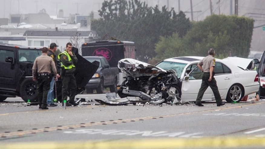 Feb. 7, 2015: Los Angeles County Sheriff's deputies investigate the scene of a collision involving three vehicles in Malibu, Calif. (AP)